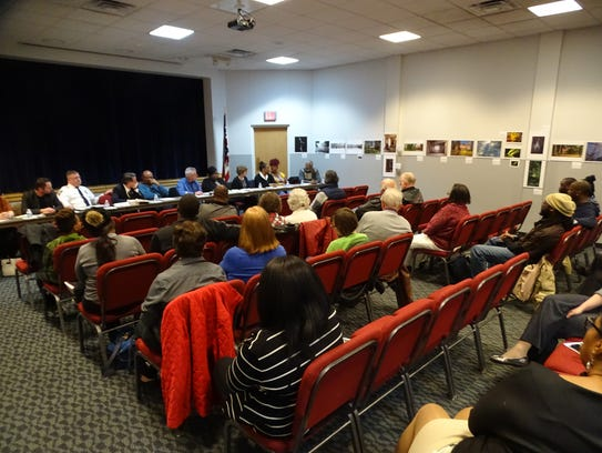 Local residents interact with a panel at the State