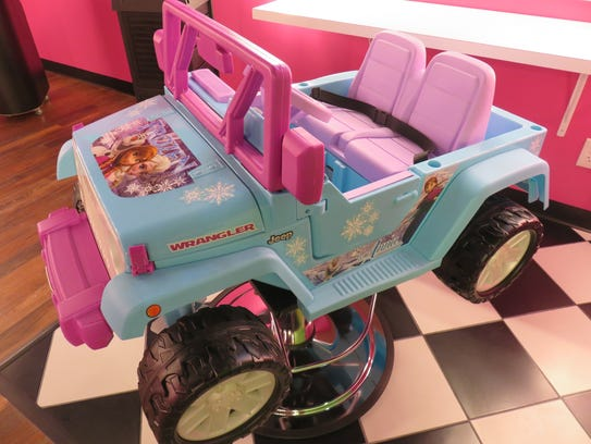 Car/barber chair in girls lounge area