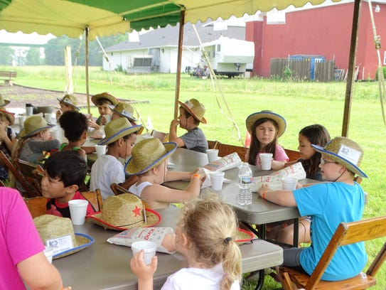 At Cowboy Camp, children do crafts and eat snacks as