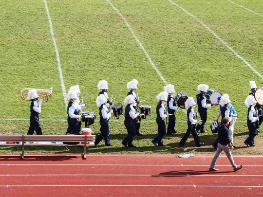 The Brandywine marching band leaves the field after performing at the Brandywine-St. Georges game Oct. 29 .