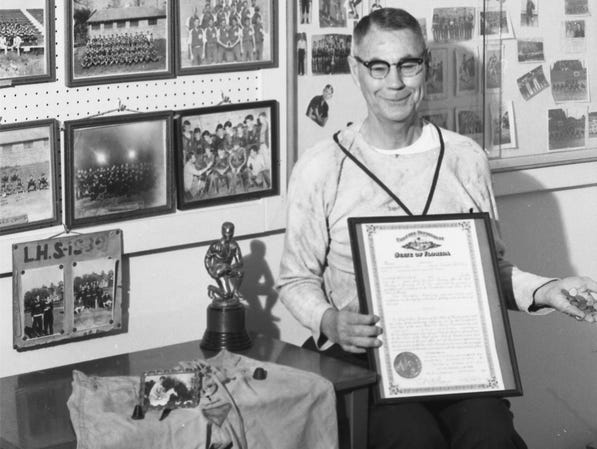 In 1965, Amos P. Godby retired from the Leon County School system. Seen here, he poses with all the memorabilia acquired over a 30-year career.