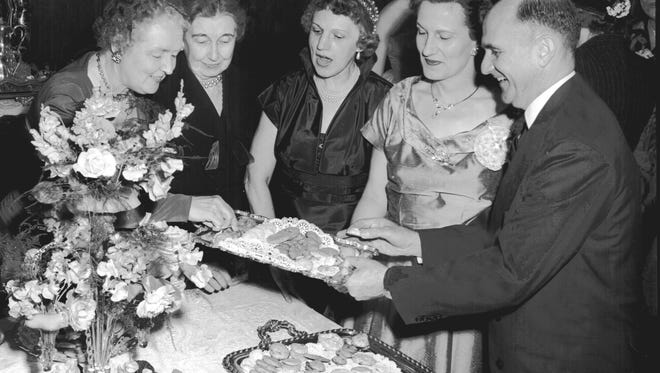 Beside a 200-year-old centerpiece of Bohemian glass, the Women of First Presbyterian Church shared cookies and fellowship with more than 50 new women members in April 1954.  The tea at 1862 Overton Park also honored Dr. Robert S. Hough (Right) on his first anniversary as pastor.  At the table were (From Left) Mrs. J. Wellford Withers of 1116 Poplar, Mrs. W.H. Matthews of the Overton Park address, Mrs. Curt Porter of 455 South Parkway East and Mrs. Hough.
