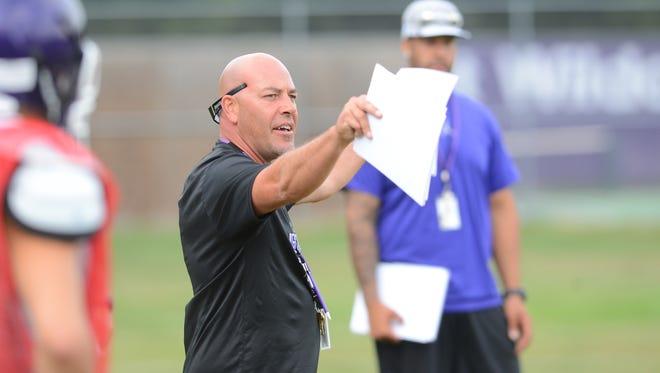 West High School head football coach Jeff Behrendt directs practice on Monday