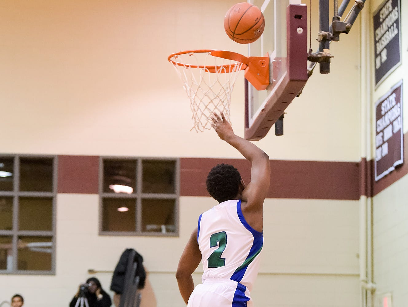 Kyson Rawls (No. 2) of St. Georges Technical High School takes the ball to the net.