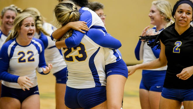 Titusville players celebrate a win during Thursday's match against Viera.