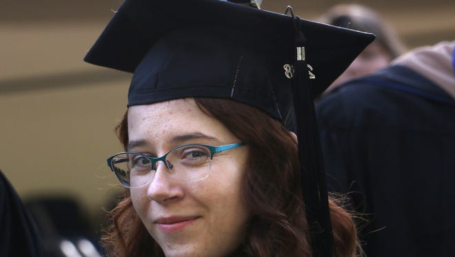 Allison Blair walks during the University of Nevada, Reno commencement ceremony on Saturday morning, May 19, 2018.