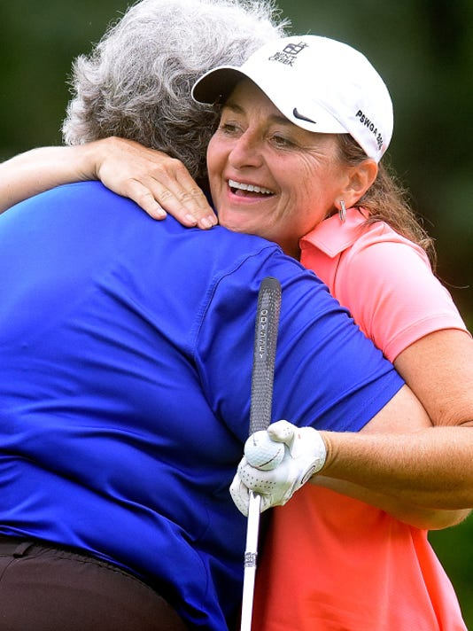 Amy Kennedy hugs Maggie Ryan, left, after Kennedy won the Women's York County Amateur Golf Association championship at Range End Golf Club on Thursday. Kennedy won the match-play event, 7&6.