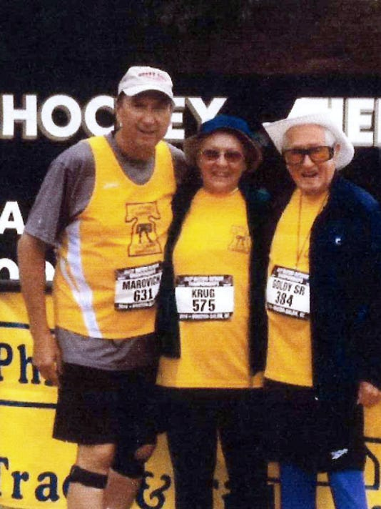 Gloria Krug, 84, stands with Dave Marovich, 70, to her left, and Champ Gordy, 98, to her right after all three competed at the Philadelphia Masters Track & Field Association meet earlier this year.