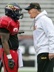 One Randy Edsall's assistants says Edsall has a great feel for when to pat a player on the back, or to get in his face, as he does here with  Cavon Walker during an intersquad scrimmage at Byrd Stadium in College Park, Md. in April.