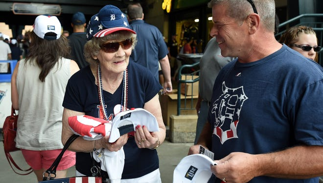 Already decked out in red, white and blue, Millie Tiernan of Rochester Hills, left, checks out the hat given away for the Fourth of July with her son, Lou Tiernan of Waterford.