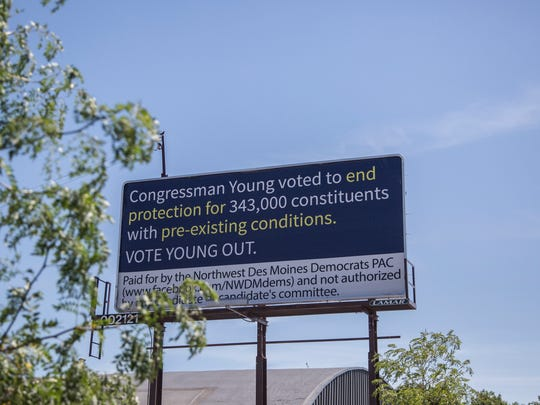 This billboard criticizing Congressman David Young in Des Moines' East Village was paid for by the Northwest Des Moines Democrats PAC, photographed on Tuesday, June 27, 2017, in Des Moines.