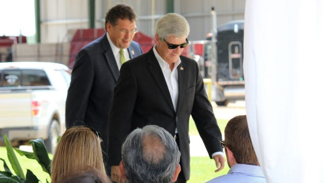 Gov. Phil Bryant is shown in this July 21, 2014, file photo in Philadelphia, where officials with Weyerhaeuser Company said they will invest more than $57 million over a three-year period to expand their softwood lumber mill. Bryant boasted on the Weyerhaeuser news during his Neshoba County Fair speech July 31.