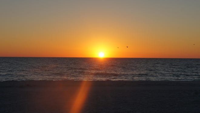 Sunsets overlooking the Gulf of Mexico draw large crowds on Anna Maria Island.