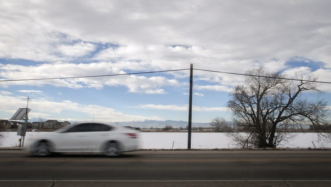 A car travels south on Highway 257 on Dec. 15, 2013 in Windsor. The Highway 257 bridge over the Big Thompson River will close that stretch of road for a month starting Sept. 14.