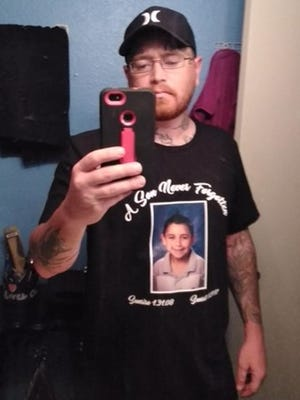 Kansas Lavarnia wears a shirt with a picture of his son, Landen.