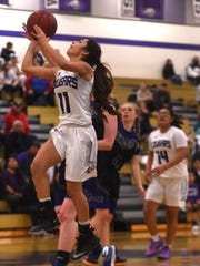 Spanish Springs' Naelia Pinedo (11) drives to the basket while taking on McQueen during their basketball game at Spanish Springs on Jan. 26, 2018.