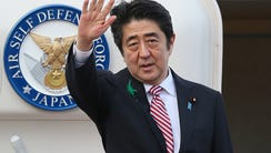 Japanese Prime Minister Shinzo Abe leaves for Indonesia