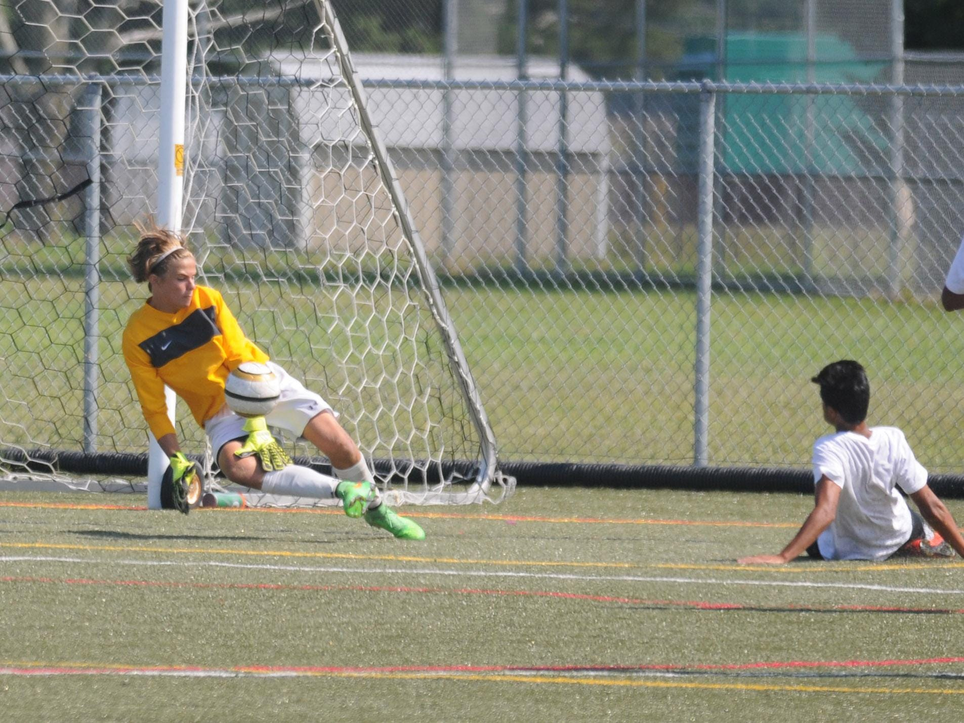 The Stephen Decatur goalkeeper comes up with a save against Indian River during the Cape Henlopen play day.