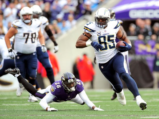 San Diego Chargers tight end Antonio Gates runs with the ball past Baltimore Ravens safety Brynden Trawick on Nov. 30.
