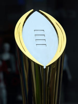 General view of the College Football Playoff national championship trophy.