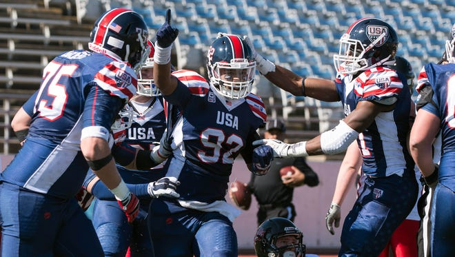 Mario Osborne (92), shown here celebrating after intercepting a pass thrown by Team Canada's Liam Putt while playing for Team USA in the 2015 International Bowl in Arlington, Texas, could be UL's starting defensive end this season.