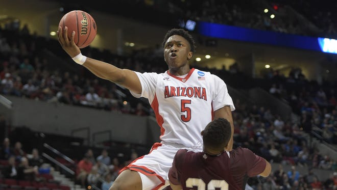 March 19, 2015; Portland, Ore.; Arizona Wildcats forward Stanley Johnson (5) shoots against Texas Southern Tigers forward Jason Carter (23) during the first half in an NCAA Tournament game at Moda Center.