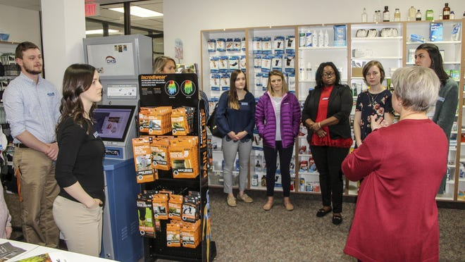 University of Kansas School of Pharmacy students listen as Robin Schenck, pharmacist and owner of Plaza Pharmacy, right, shares information about her pharmacy Wednesday during the group's tour of independent pharmacies in Kansas.