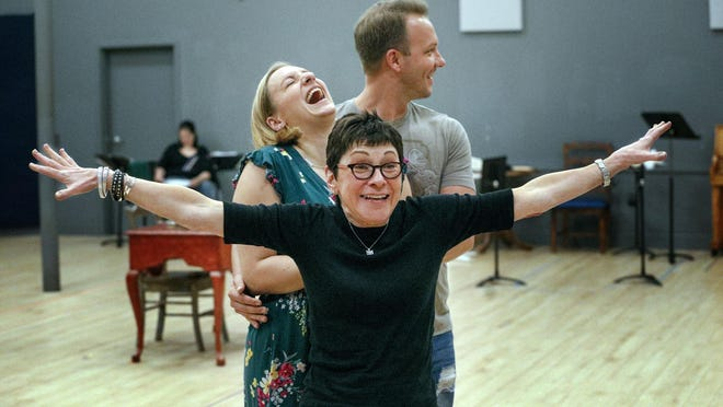 Helena Binder, stage director for Palm Beach Opera's production of The Barber of Seville, has some fun with performers Aleks Romano, left, and Taylor Stayton, right, during a rehearsal at the company's production center. Romano will play Rosina and Stayton will play Count Almaviva.