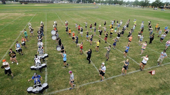 Members of the Ashland High School marching band practice their marching at camp on Tuesday.