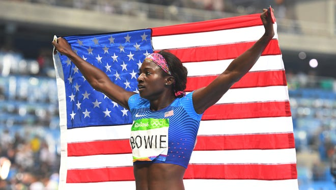 Tori Bowie (USA) celebrates after claiming a bronze medal during the women's 200-meter final.