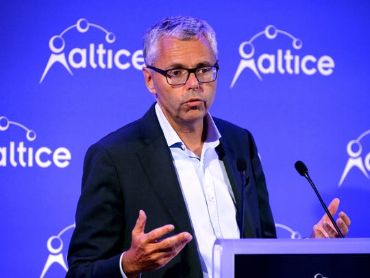 Altice CEO Michel Combes talks during a press conference