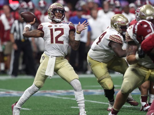 FSU's Deondre Francois throws the ball against Alabama during their game at the Mercedes-Benz Stadium in Atlanta on Saturday, Sept. 2, 2017.