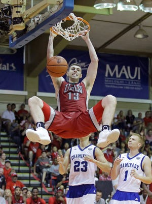 UNLV forward Ben Carter (13) dunks against Chaminade's Kevin Hu (23) and Dantley Walker (1) during the second half of an NCAA college basketball game in the second round of the Maui Invitational, Tuesday, Nov. 24, 2015, in Lahaina, Hawaii.