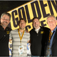 Ryan Ferguson, second from left, and his father Bill,  far right, receive Super Bowl tickets from Golden Tickets co-owners Ram Silverman, far left, and Steve Parry, second from right, in Phoenix, Arizona, Jan. 29, 2015.
