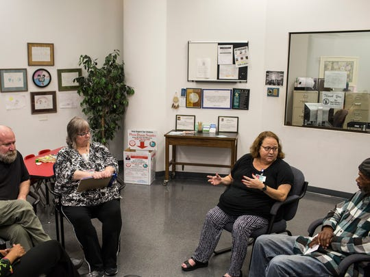 November 3, 2016 - Anna Whalley, Administrator of Crime Victim Services for Shelby County, second from right, talks about the first gunshot survivor group meeting at Shelby County Crime Victims Center.