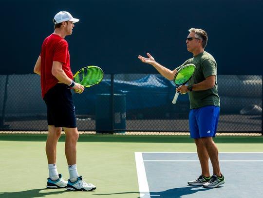 Craig Boynton coaches Sam Querrey, during a practice
