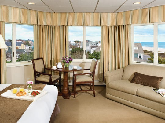 Luxury category rooms feature a sofa, fireplace and
