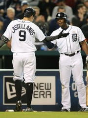 Tigers third baseman Nick Castellanos and leftfielder Justin Upton celebrate his homer during the seventh inning of the Tigers' win Monday.