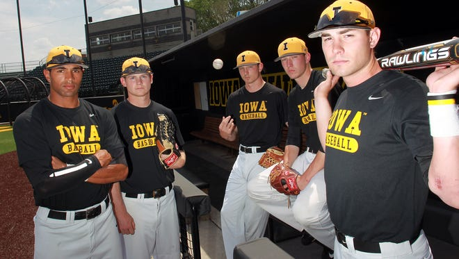 Iowa seniors, from left, Kris Goodman, Eric Toole, Nick Day, Nick Hibbing and Jake Mangler are shown at Duane Banks Field. The Hawkeyes are nearing their first 40-win season since 1985.