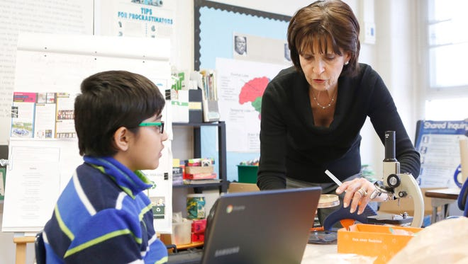 Instructional facilitator Lynda Hammond, right, works with Pratham Sethia, 10, in the Tinkering and Engineering classroom at the Viola Elementary School in Montebello on Friday, February 3, 2017.