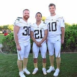 A pair of former Shippensburg University football standouts are once again headed to the Pro Bowl. In this photo, former Red Raiders John Kuhn, left, and Brent Grimes, center, pose with New York Giants quarterback Eli Manning while practicing at the Pro Bowl in Hawaii on on Friday. Kuhn is a fullback for the Green Bay Packers, and Grimes is a cornerback for the Miami Dolphins. The Pro Bowl is at 7 p.m. on Sunday and will be televised on ESPN.