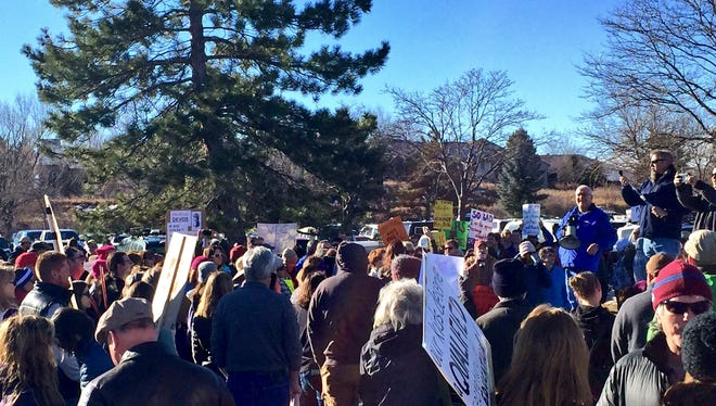 Hundreds of people gathered Saturday morning at Rolland Moore Park in Fort Collins to protest the nomination of Betsy DeVos for U.S. Secretary of Education.