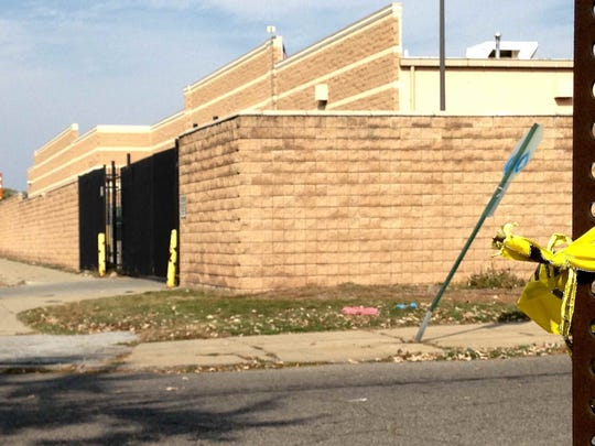 A shooting left one dead after the victim in a Black F150 Ford crashed into a stop sign by a Home Depot lot off Myers in Detroit, Monday morning, October 12, 2015.