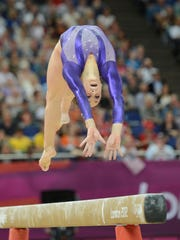 Jordyn Wieber (USA) competes on the beam during the women's team qualification during the London 2012 Olympic Games at North Greenwich Arena.