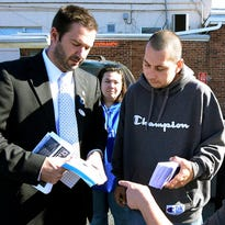 West York Borough Councilman Shawn Mauck, left, looks at campaign literature at the Reliance Fire Hall polling site Tuesday, Nov. 3, 2015. Bill Kalina - bkalina@yorkdispatch.com