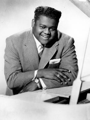 FILE - This 1956 file photo shows singer, composer and pianist Fats Domino. The amiable rock 'n' roll pioneer whose steady, pounding piano and easy baritone helped change popular music even as it honored the grand, good-humored tradition of the Crescent City, has died. He was 89. Mark Bone, chief investigator with the Jefferson Parish, Louisiana, coroner's office, said Domino died Tuesday, Oct. 25, 2017. (AP Photo, File)