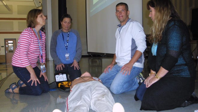 Granville Intermediate staff members participated in a CPR training drill in an effort to make all four schools heart safe.