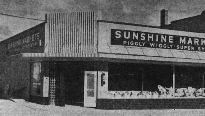 The Sunshine grocery store at Seventh and Main, pictured around 1941.