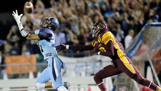 Chapin wide receiver Gilbert Arellano catches a long pass over Andress safety Tristan Cooper Friday at Andress High School.