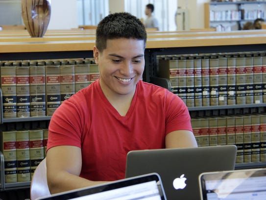 College of the Sequoias student Agustin Rodriguez, sophomore, works on an assignment at the Visalia college's campus library in October 2017.